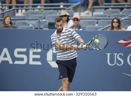 New York, NY - August 31, 2015: Benoit Paire of France returns ball during 1st round match against Kei Nishikori of Japan at US Open Championship  - stock photo