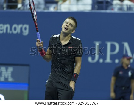 New York, NY - August 31, 2015: Borna Coric of Croatia reacts during 1st round match against Rafael Nadal of Spain at US Open Championship - stock photo