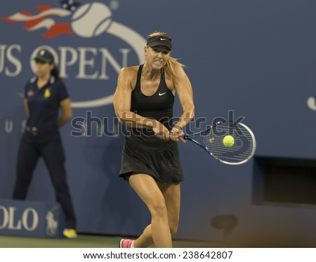 NEW YORK, NY - AUGUST 25: Maria Sharapova of Russia returns ball during 1st round match against Maria Kirilenko of Russia at US Open tennis tournament in Flushing Meadows USTA Tennis Center 2014 - stock photo