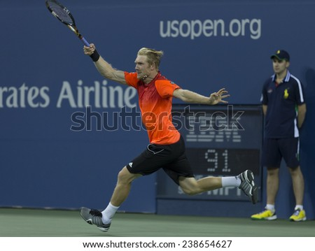 NEW YORK, NY - AUGUST 28: Matthias Bachinger of Germany returns ball during 2nd round match against Andy Murray of United Kingdom at US Open tennis tournament in Flushing Meadows USTA Tennis Center 2014 - stock photo