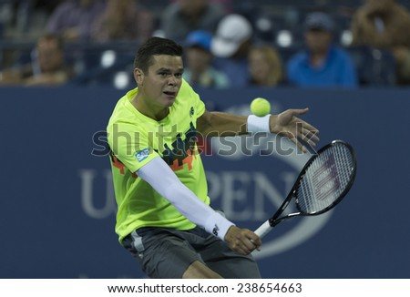 NEW YORK, NY - AUGUST 28: Milos Raonic of Canada returns ball during 2nd round match against Peter Gojowczyk of Germany at US Open tennis tournament in Flushing Meadows USTA Tennis Center 2014 - stock photo