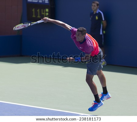 NEW YORK, NY - AUGUST 25: Nick Kirgious of Australia serves ball during 1st round match against Mikhail Youzhny of Russia at US Open tennis tournament in Flushing Meadows USTA Tennis Center 2014 - stock photo