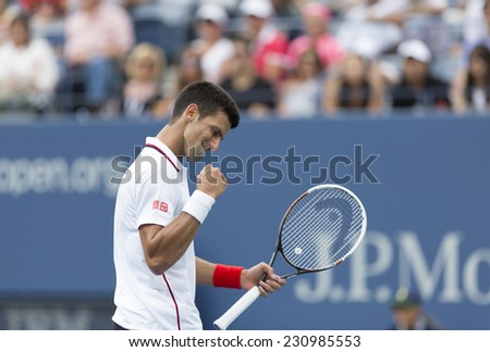 NEW YORK, NY - AUGUST 30, 2014: Novak Djokovic of Serbia reacts during 3rd round match against Sam Querrey of USA at US Open tennis tournament in Flushing Meadows USTA Tennis Center - stock photo