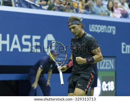 New York, NY - August 31, 2015: Rafael Nadal of Spain reacts during 1st round match against Borna Coric of Croatia at US Open Championship - stock photo