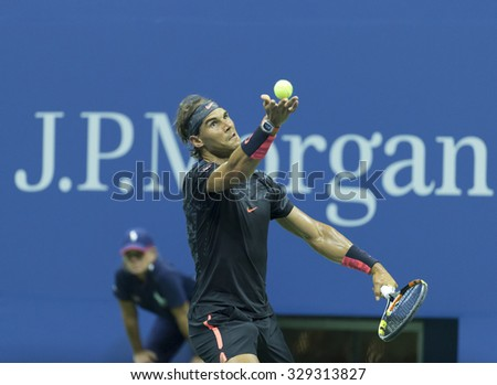 New York, NY - August 31, 2015: Rafael Nadal of Spain serves during 1st round match against Borna Coric of Croatia at US Open Championship - stock photo