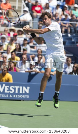 NEW YORK, NY - AUGUST 25: Robin Haase of Netherland returns ball during 1st round match against Andy Murray of United Kingdom at US Open tennis tournament in Flushing Meadows USTA Tennis Center 2014 - stock photo