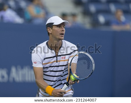 NEW YORK, NY - AUGUST 29, 2014: Tomas Berdych of Czech Republic serves ball during 2nd round match against Martin Klizan of Slovakia at US Open tennis tournament in Flushing Meadows USTA Tennis Center - stock photo