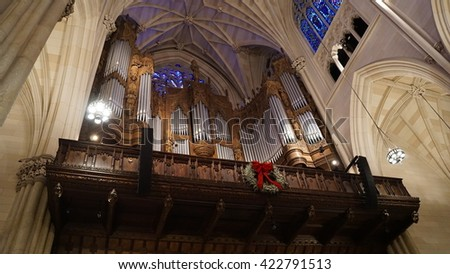 NEW YORK, NY - DEC 20: St Patrick's Cathedral in New York during Christmas season, as seen on Dec 20, 2015. It is the seat of the archbishop of the Roman Catholic Archdiocese of New York. - stock photo