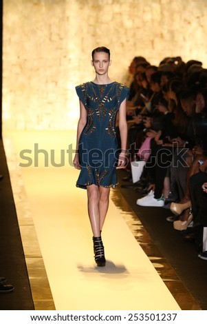 NEW YORK, NY - FEBRUARY 14: A model walks the runway at Herve Leger by Max Azria fashion show during Mercedes-Benz Fashion Week Fall 2015 at Lincoln Center on February 14, 2015 in New York City - stock photo