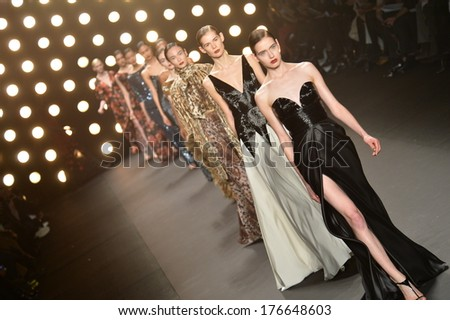 NEW YORK, NY - FEBRUARY 11: A model walks the runway at Naeem Khan Fall 2014 Collection during Mercedes-Benz Fashion Week Fall 2014 at Lincoln Center on February 11, 2014 in New York City. - stock photo