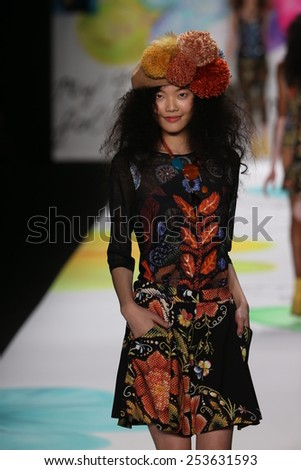 NEW YORK, NY - FEBRUARY 12: A model walks the runway at the Desigual fashion show during Mercedes-Benz Fashion Week Fall 2015 at The Theatre at Lincoln Center on February 12, 2015 in New York City.  - stock photo