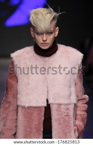 NEW YORK, NY - FEBRUARY 09: A model walks the runway at the DKNY Women's fashion show during Mercedes-Benz Fashion Week Fall 2014 on February 9, 2014 in New York City. - stock photo