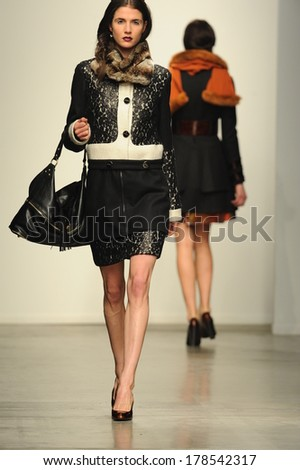 NEW YORK, NY - FEBRUARY 12: A model walks the runway at the L.Catherine London show during Nolcha Fashion Week New York Fall/Winter 2014 at Pier 59 on February 12, 2014 in NYC - stock photo