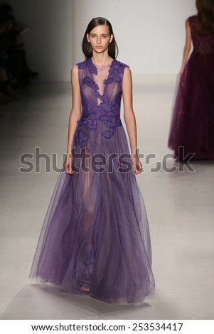 NEW YORK, NY - FEBRUARY 12: A model walks the runway at the Tadashi Shoji show during Mercedes-Benz Fashion Week Fall 2015 at The Salon at Lincoln Center on February 12, 2015 in New York City. - stock photo