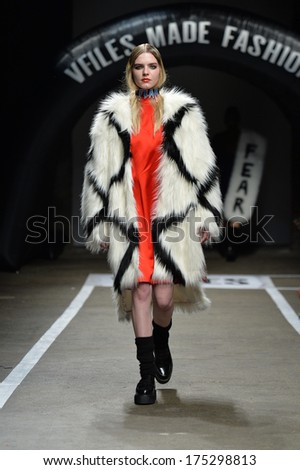 NEW YORK, NY - FEBRUARY 05: A model walks the runway for the designs of Heyein Seo for VFiles Made Fashion 2 show during Mercedes Benz Fashion Week at Eyebeam on February 5, 2014 in New York City. - stock photo