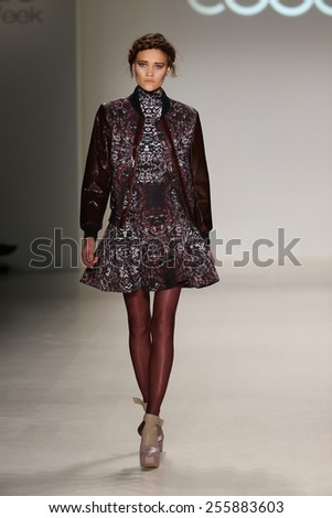 NEW YORK, NY - FEBRUARY 19: A model walks the runway in a design by Esosa at the New York Life fashion show during MBFW Fall 2015 at Lincoln Center on February 19, 2015 in NYC.  - stock photo