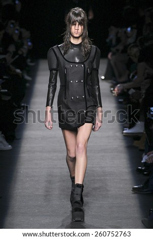 NEW YORK, NY - FEBRUARY 14: A model walks the runway wearing Alexander Wang during MBFW in New York at Pier 94 on February 14, 2015 in NYC. - stock photo