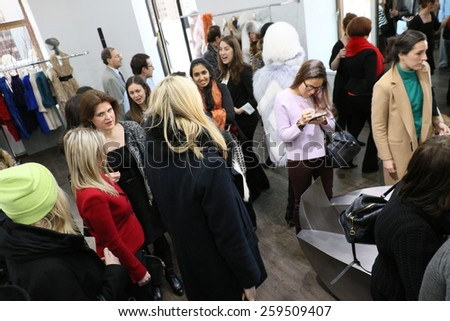 NEW YORK, NY - FEBRUARY 12: Guests attends the Helen Yarmak presentation during MBFW Fall 2015 at 730 Fifth Avenue on February 12, 2015 in NYC - stock photo
