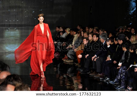 NEW YORK, NY - FEBRUARY 10: Karlie Kloss walks the runway at Donna Karan New York 30th Anniversary during Mercedes-Benz Fashion Week Fall 2014 at 23 Wall Street on February 10, 2014 in New York City.  - stock photo