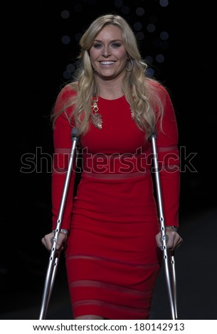 NEW YORK, NY - FEBRUARY 06, 2014: Lindsey Vonn on cratches wearing Cynthia Rowley dress walks runway for The Heart Truth's Red Dress Collection at Mercedes-Benz Fall/Winter 2014 Fashion Week - stock photo