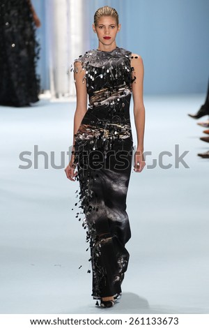 NEW YORK, NY - FEBRUARY 16: Model Devon Windsor walks the runway wearing Carolina Herrera Fall 2015 Collection during MBFW at Lincoln Center on February 16, 2015 in NYC - stock photo