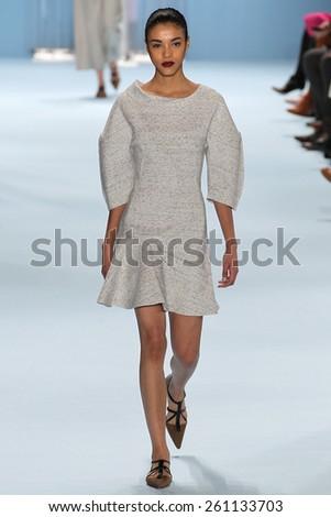 NEW YORK, NY - FEBRUARY 16: Model Sasha Hronis walks the runway wearing Carolina Herrera Fall 2015 Collection during MBFW at Lincoln Center on February 16, 2015 in NYC - stock photo