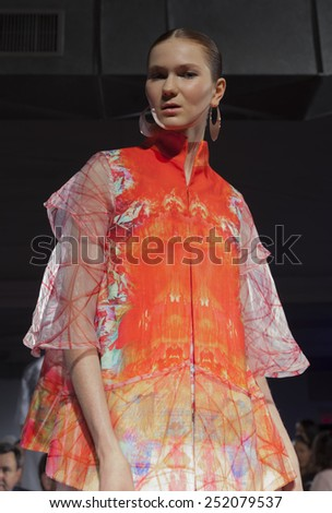 NEW YORK, NY - FEBRUARY 10, 2015: Model shows off dress by designer Elisa Guillen at Epson Digital Couture Presentation at Fall 2015 Mercedes-Benz Fashion Week at Industria Super Studio - stock photo