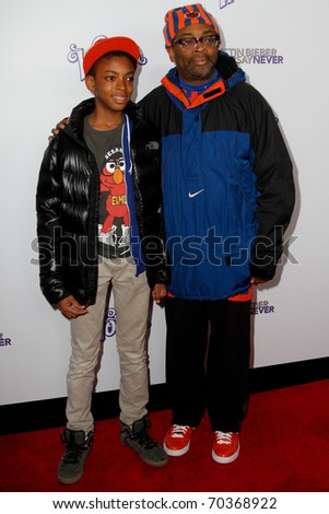 "NEW YORK, NY - FEBRUARY 02: Spike Lee and son, Jackson, attend the ""Justin Bieber: Never Say Never"" New York movie premiere at the Regal E-Walk 13 Theater on February 2, 2011 in New York City. - stock photo"