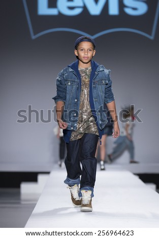 New York, NY - February 12,2015: Young model walks runway for Kids Rock Fashion show during Fall 2015 Fashion Week in Lincoln Center - stock photo