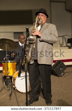 New York, NY - January 14, 2016: Joe Lovano plays saxophone at charity concert Jazz Legends for Disability Pride during Winter Jazz festival at Quaker Friends Meeting Hall - stock photo