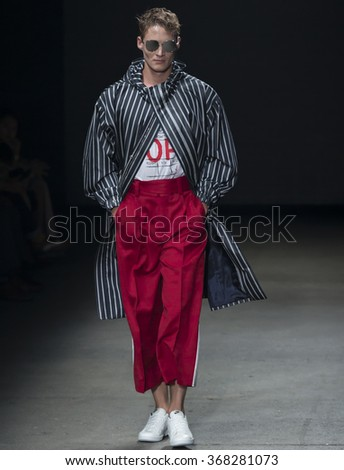 NEW YORK, NY - JULY 14, 2015: A model walks the runway during the Concept Korea show at New York Fashion Week Men's S/S 2016 at Skylight Clarkson Sq - stock photo
