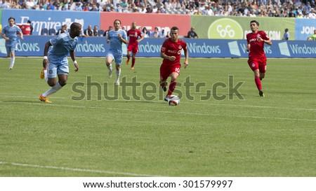 New York, NY - July 12, 2015: Sebastian Giovinco (10) controls the ball during game between New York City FC and Toronto FC at Yankee Stadium - stock photo