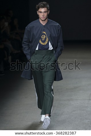 NEW YORK, NY - JULY 14, 2015: Tyler Recher walks the runway during the Concept Korea show at New York Fashion Week Men's S/S 2016 at Skylight Clarkson Sq - stock photo