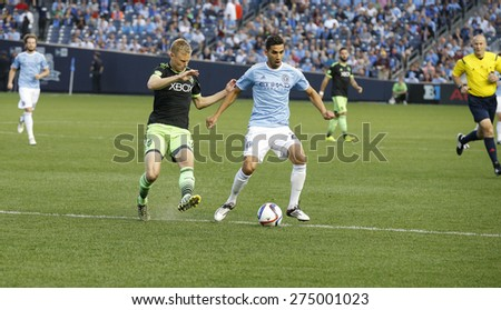 New York, NY - May 3, 2015: Mehdi Ballouchy of NYFC controls ball during MLS game between New York Football Club and Seattle Sounders FC at Yankee Stadium - stock photo