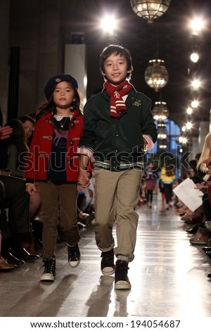 NEW YORK, NY - MAY 19: Models walk the runway at the Ralph Lauren Fall 14 Children's Fashion Show in Support of Literacy at New York Public Library on May 19, 2014 in New York City.  - stock photo