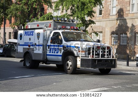 NEW YORK, NY - MAY 31: NYPD police truck patrolling the streets in New York City on May 31, 2011.  The NYPD is one of the oldest police departments in the US established in 1845. - stock photo
