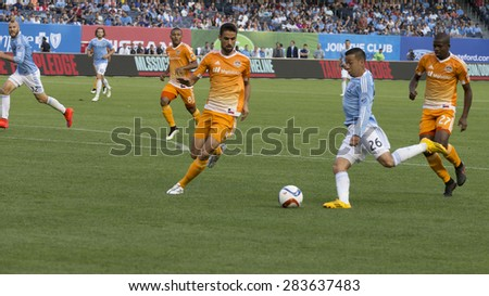 New York, NY - May 30, 2015: Sebastian Velasquez (26) of NYCFC controls ball during the game between New York City Football Club and Houston Dynamo at Yankee Stadium - stock photo