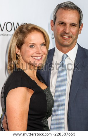 NEW YORK, NY - NOVEMBER 05: Katie Couricand husband John Molner attends the 2014 Stand Up For Heroes at Madison Square Garden on November 5, 2014 in New York City. - stock photo