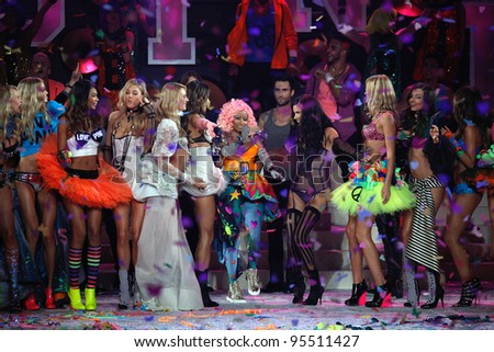 NEW YORK, NY - NOVEMBER 09: Nicki Minaj and members of Maroon 5 pose with models on the runway during the 2011 Victoria's Secret Fashion Show at the Lexington Avenue Armory on November 9, 2011 in NYC. - stock photo