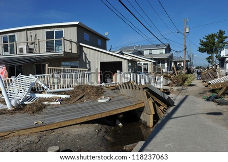 NEW YORK, NY - NOVEMBER 09: Scenes of Hurricane Sandy's aftermath in the Breezy Point part of Far Rockawayon November 9, 2012 in the Queens borough of New York City. - stock photo