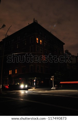 NEW YORK, NY - NOVEMBER 1: Solitary apartment lit by candlelight in the West Village during blackout caused by Hurricane Sandy on Nov 1st 2012 in New York. Many apartment dwellers have left lower Manhattan - stock photo