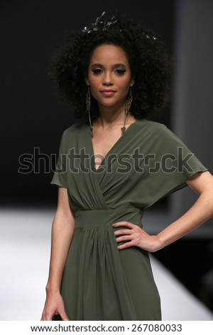 NEW YORK, NY - OCTOBER 12: A model walks runway at Ivy & Aster fashion show during Fall 2015 Bridal Collection at Pier 94 on October 12, 2014 in NYC. - stock photo
