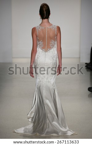 NEW YORK, NY - OCTOBER 12: A model walks runway at Matthew Christopher fashion show during Fall 2015 Bridal Collection at EZ Studios on October 12, 2014 in NYC.  - stock photo