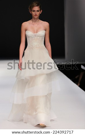 NEW YORK, NY - OCTOBER 12: A model walks the runway at the Jenny Lee Fall 2015 Bridal collection show at Pier 94 on October 12, 2014 in New York City.  - stock photo