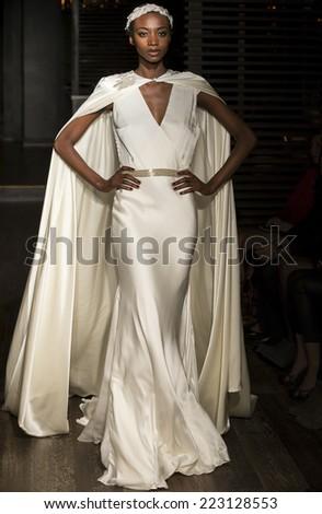 NEW YORK, NY - OCTOBER 10, 2014: A model walks the runway at the Johanna Johnson Spring 2015 Bridal Starlet - collection show at Parlor club - stock photo