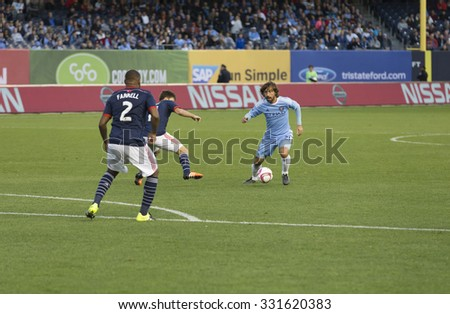 New York, NY - October 25, 2015: Andrea Pirlo (21) of NYC FC controls ball during match between NYC FC & New England Revolution at Yankee Stadium - stock photo