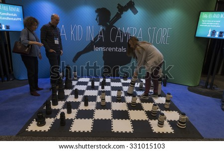 New York, NY - October 24, 2015: Chess board made of Nikon and Canon lenses at LensRental booth at Photoplus Expo in Jacob Javits Center - stock photo
