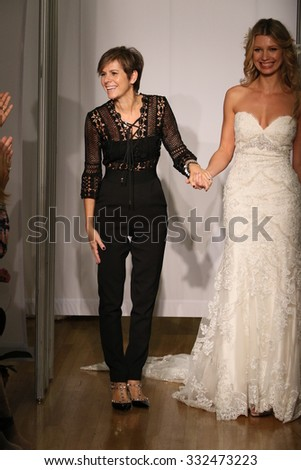 NEW YORK, NY - OCTOBER 11: Designer Madeline Gardner and model walk at Mori Lee Bridals Fall/Winter 2016 Runway Show at The Metropolitan pavilion on October 11, 2015 in NYC. - stock photo