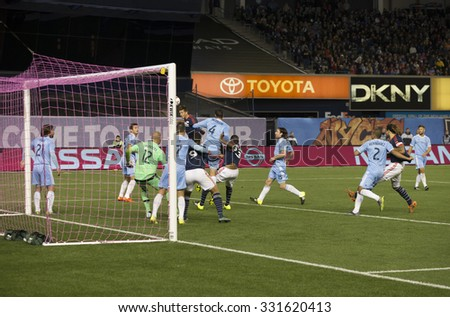 New York, NY - October 25, 2015: Kelyn Rowe (11) of New England Revolution scores goal during match between NYC FC & New England Revolution at Yankee Stadium - stock photo