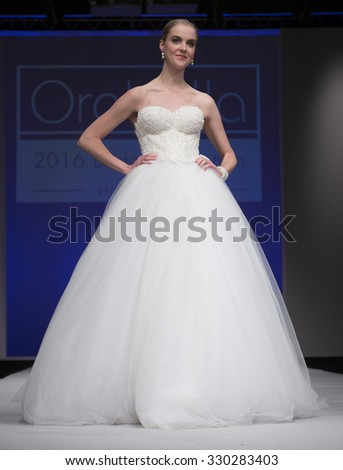 New York, NY - October 11, 2015: Model walks runway for Bridal Couture from Israel by Orabella during New York bridal week at Pier 94 - stock photo